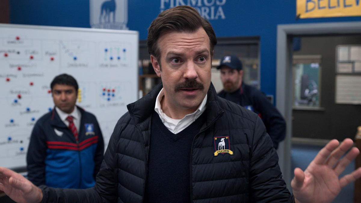 Jason Sudeikis stands in the locker room as Ted Lasso on 'Ted Lasso'