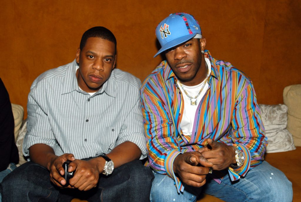 Jay-Z and Busta Rhymes sitting at the 40/40 Club