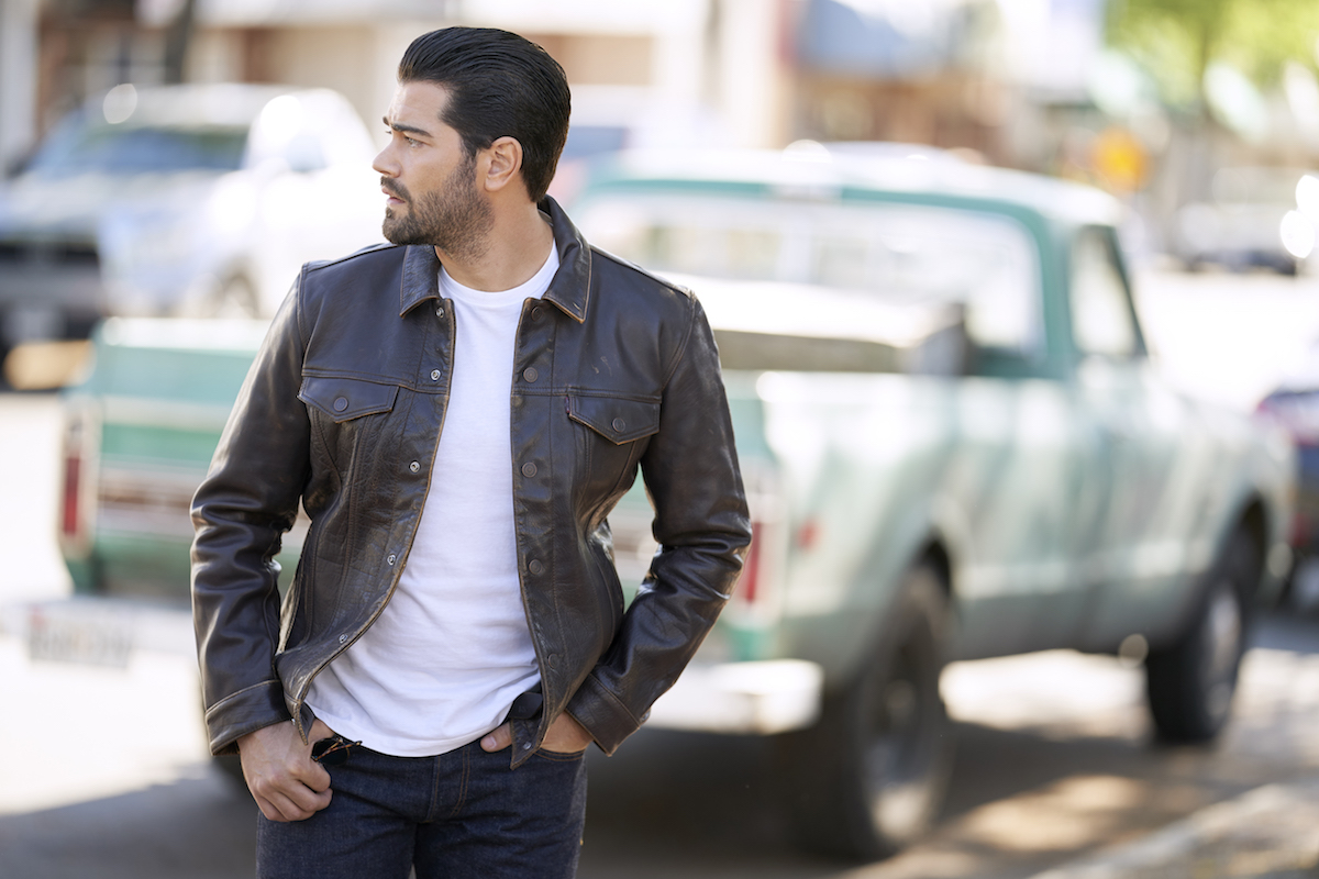 Jesse Metcalfe, looking over his shoulder, in an episode of 'Chesapeake Shores'