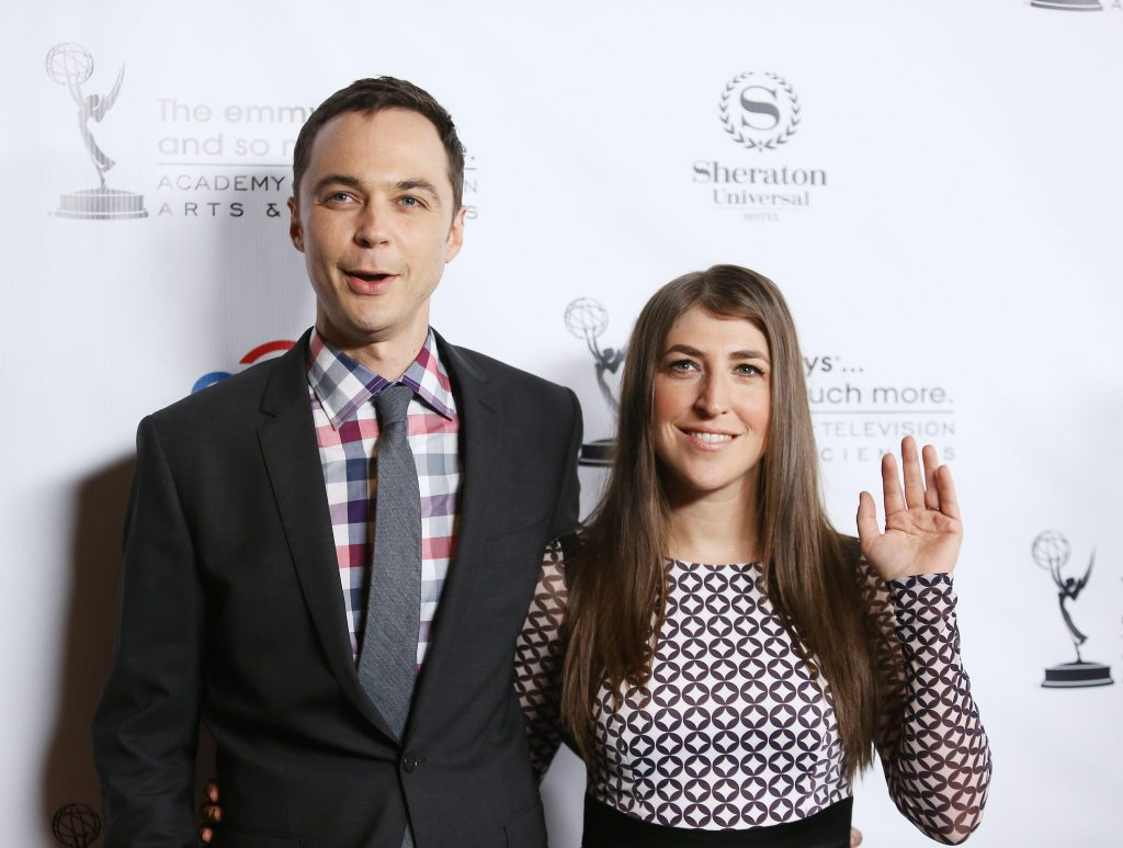 Jim Parsons and Mayim Bialik pose for a photo after arriving at the Academy of Television Arts $ Sciences' Performers Peer Group cocktail reception