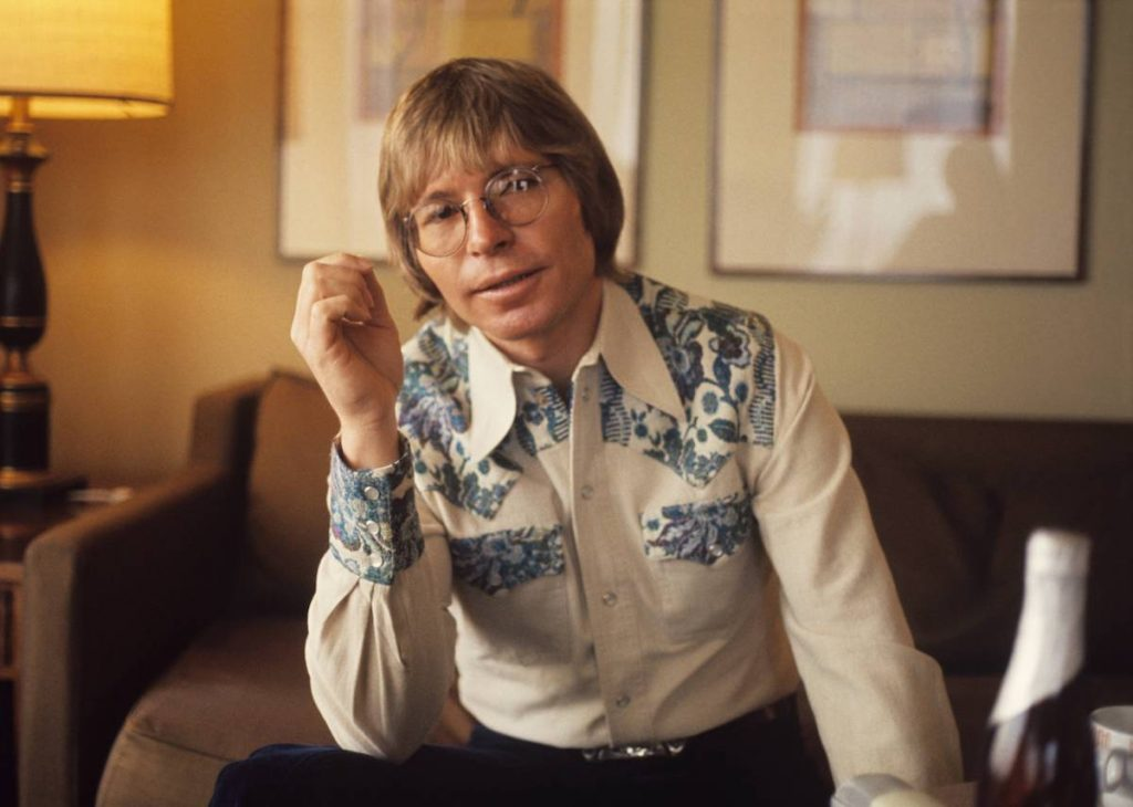 John Denver poses for a portrait in his hotel room in 1979 in Amsterdam, Netherlands.