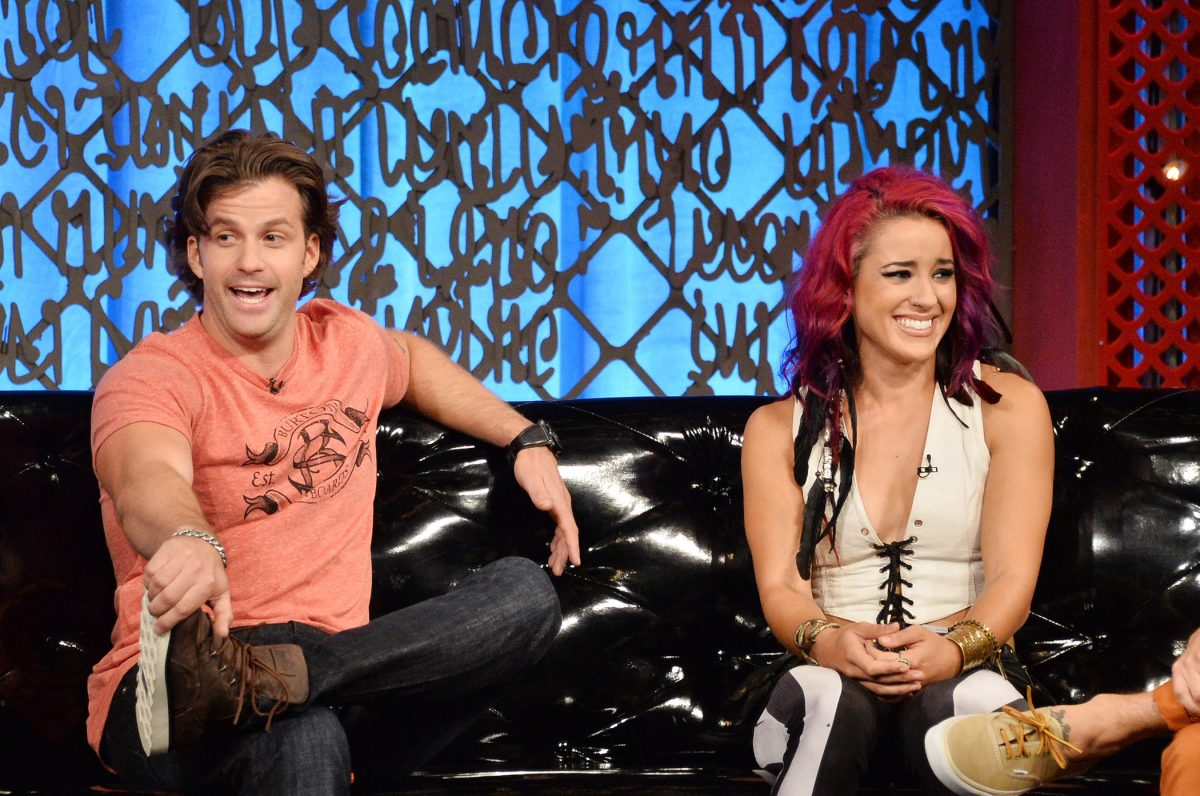 Johnny 'Bananas' Devenanzio and Cara Maria Sorbello sitting on a couch at MTV's 'The Challenge: Rivals II' final episode and reunion party