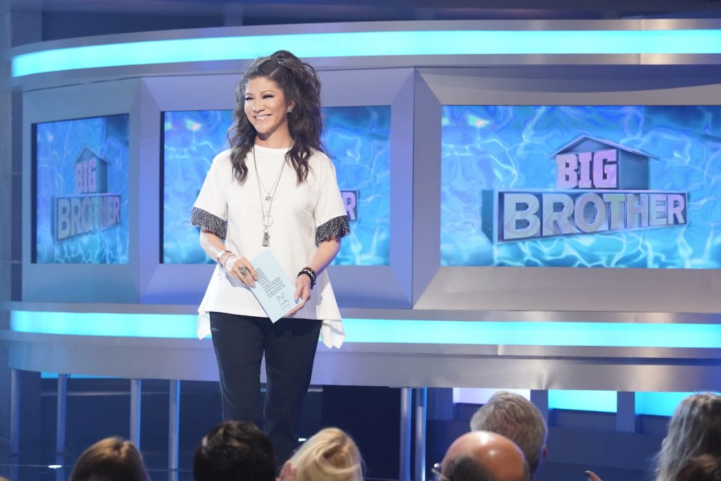 Host Julie Chen Moonves stands on stage holding a card on 'Big Brother'
