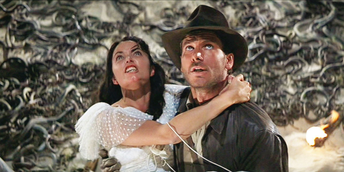 Karen Allen as Marion Ravenwood and Harrison Ford as Indiana Jones in 'Raiders of the Lost Ark' in the snake infested Well of the Souls chamber