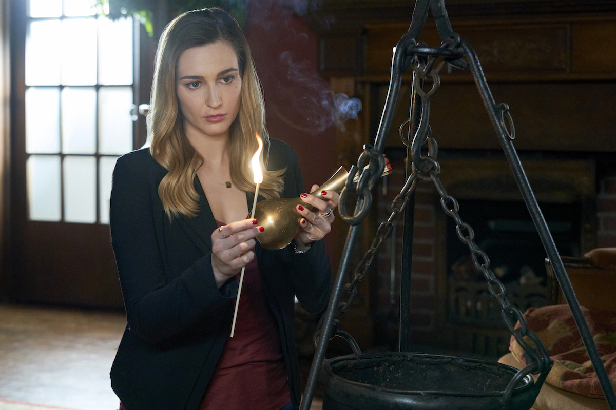 Katherine Barrell, as Joy, holding a lighted candle in the 'Good Witch' series finale.