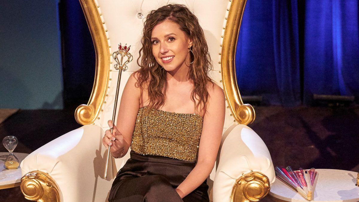 Katie Thurston holds a wand while sitting on a throne during a group date in 'The Bachelorette' Season 17 Week 6