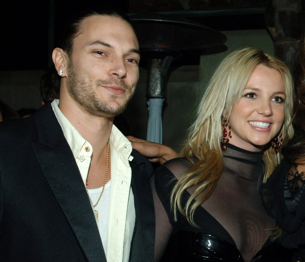 Kevin Federline and Britney Spears smiling for the media at a Grammy after party in 2006