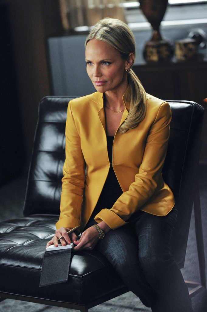 Kristin Chenoweth sitting in a scene from 'The Good Wife'