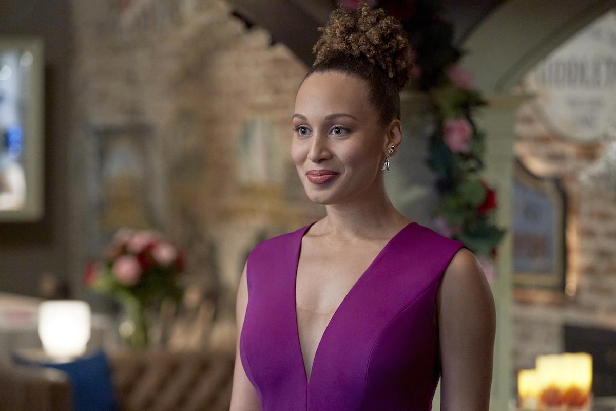 Kyana Teresa as Zoey wearing a sleeveless purple dress in 'Good Witch' series finale