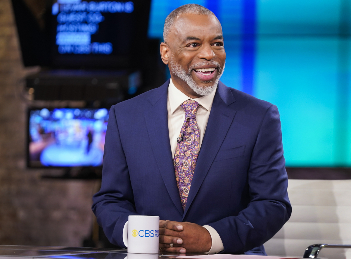 Wearing a suit and print tie, LeVar Burton smiles while guest anchoring on 'CBS This Morning.'