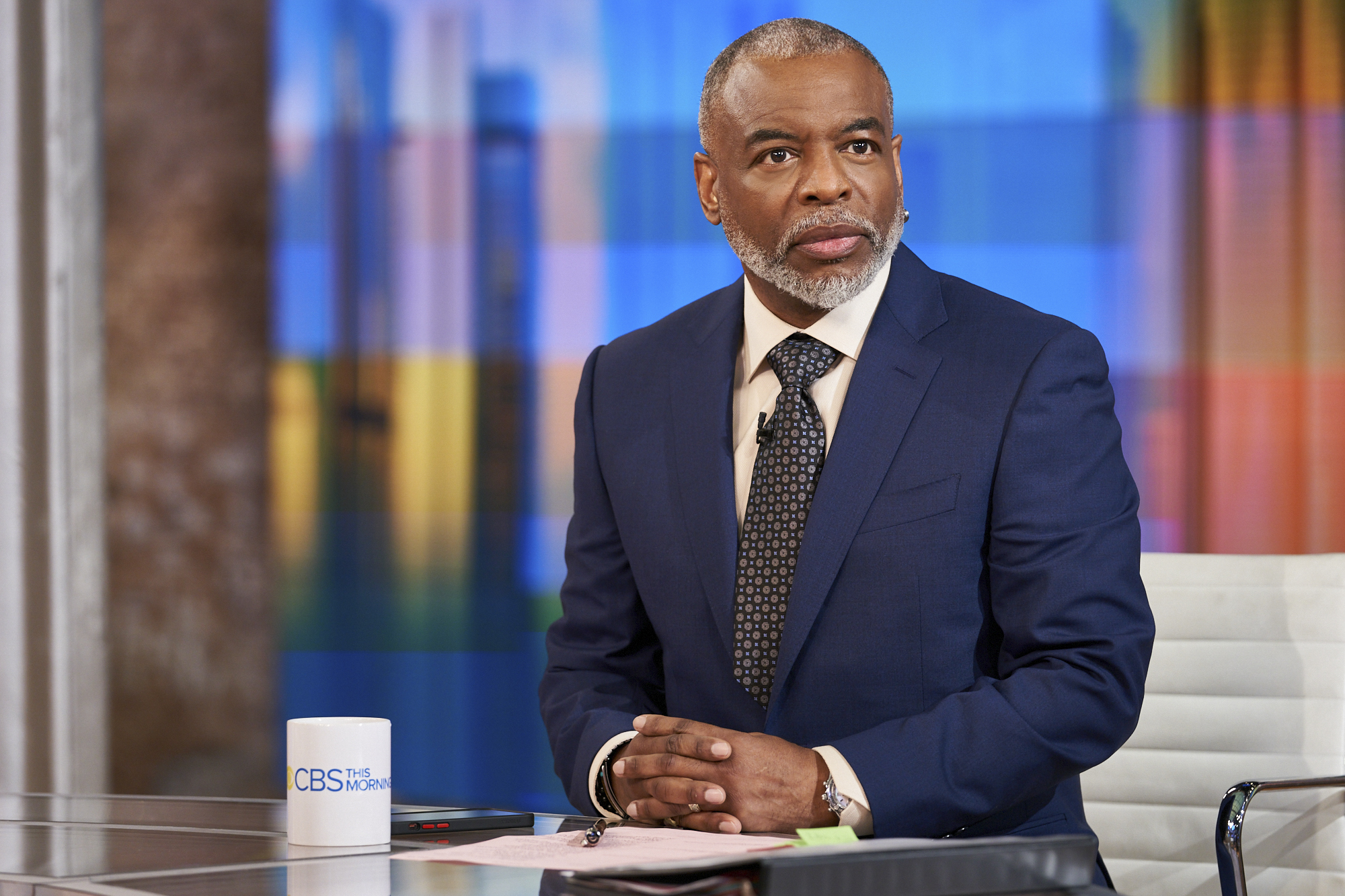 Actor LeVar Burton wears a navy blue suit and dark tie as he guest hosts on 'CBS This Morning' in May 2021.