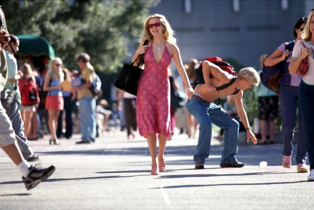 Reese Witherspoon in 'Legally Blonde' walking down a crowded street