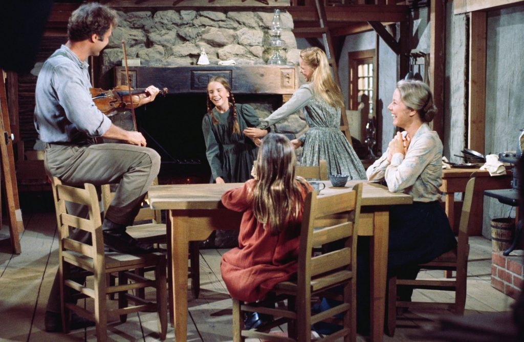 The 'Little House on the Prairie' cast of Chris Nelson playing the violin for the Ingalls family