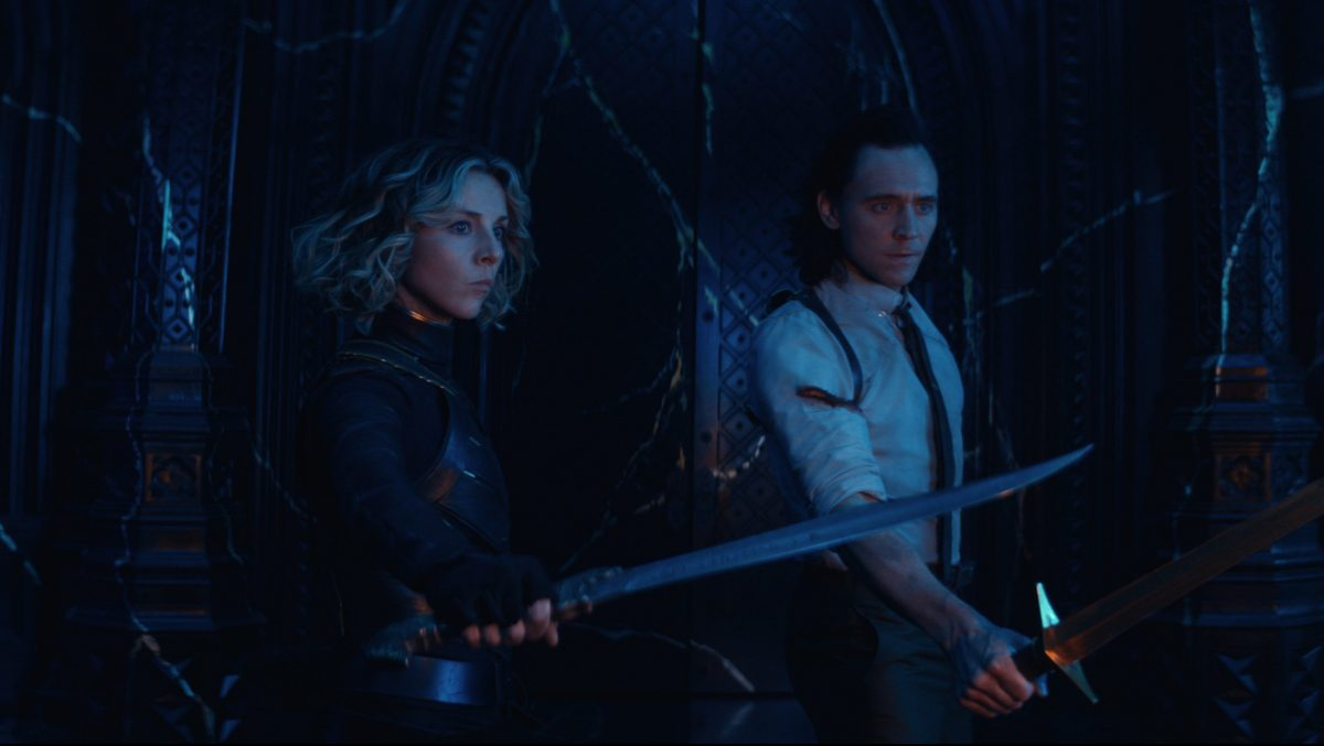 Loki (Tom Hiddleston) and Sylvie (Sophia Di Martino) holding out knives and learning who's behind the TVA, leaving questions for Season 2 of this TV series