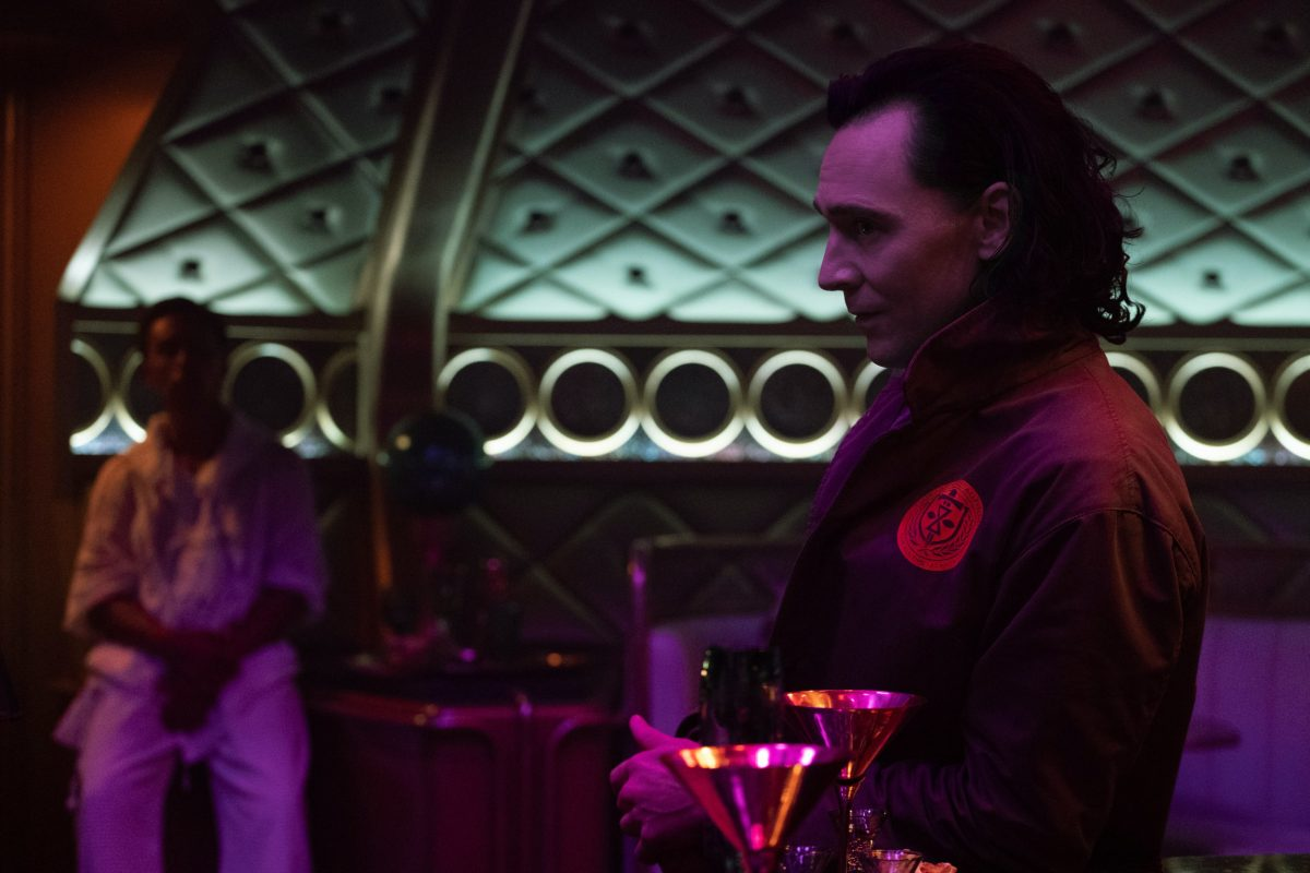 Tom Hiddleston as Loki about to drink and sing on Lamentis-1 in Marvel's 'Loki'