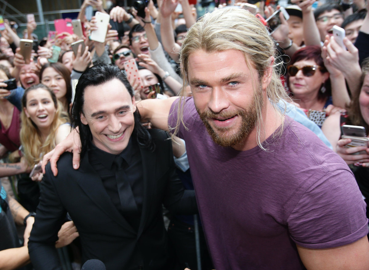 Tom Hiddleston and Chris Hemsworth meet fans whilst on set filming 'Thor: Ragnarok'. They're in costume as Loki and Thor