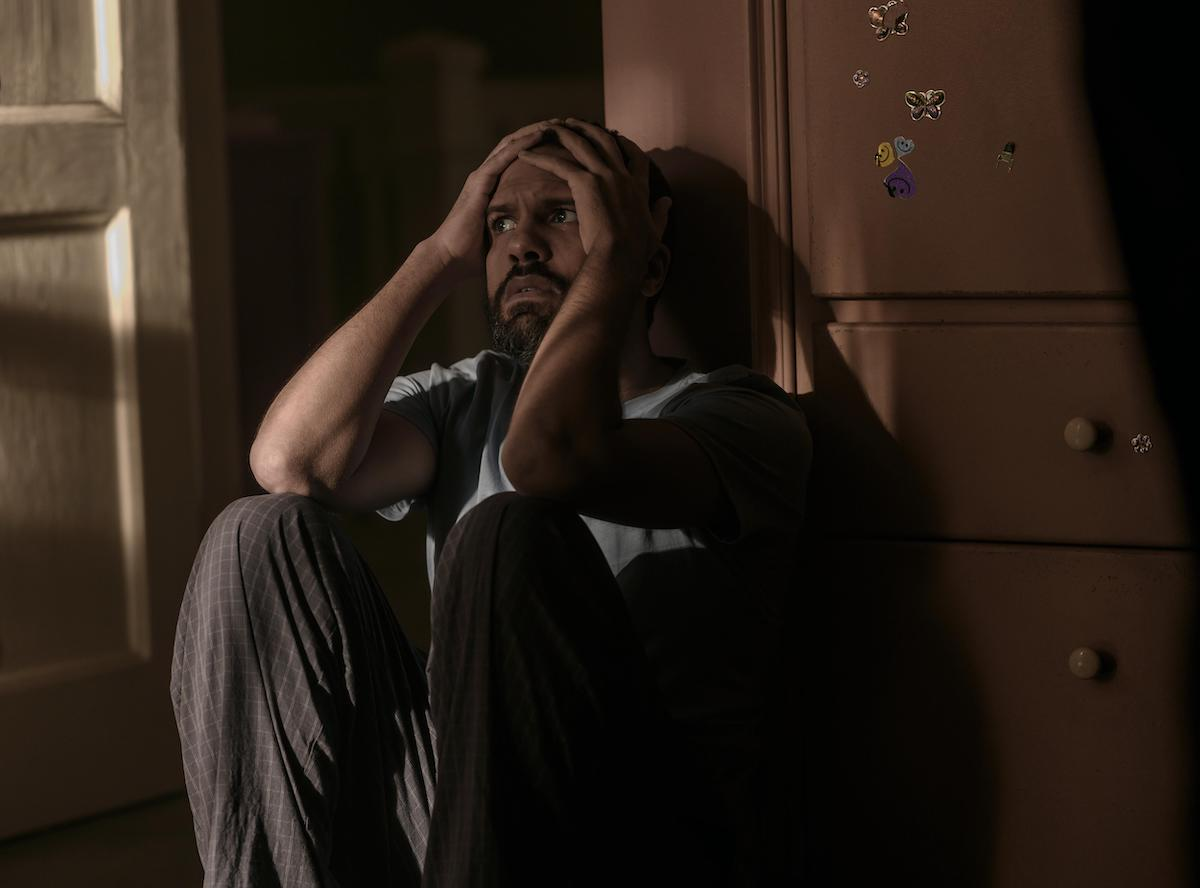 O-T Fagbenle as Luke Bankole in 'The Handmaid's Tale' Season 4 Episode 10, 'The Wilderness.' He crouches on the floor of a nursery with his hands on his head and a concerned look on his face.