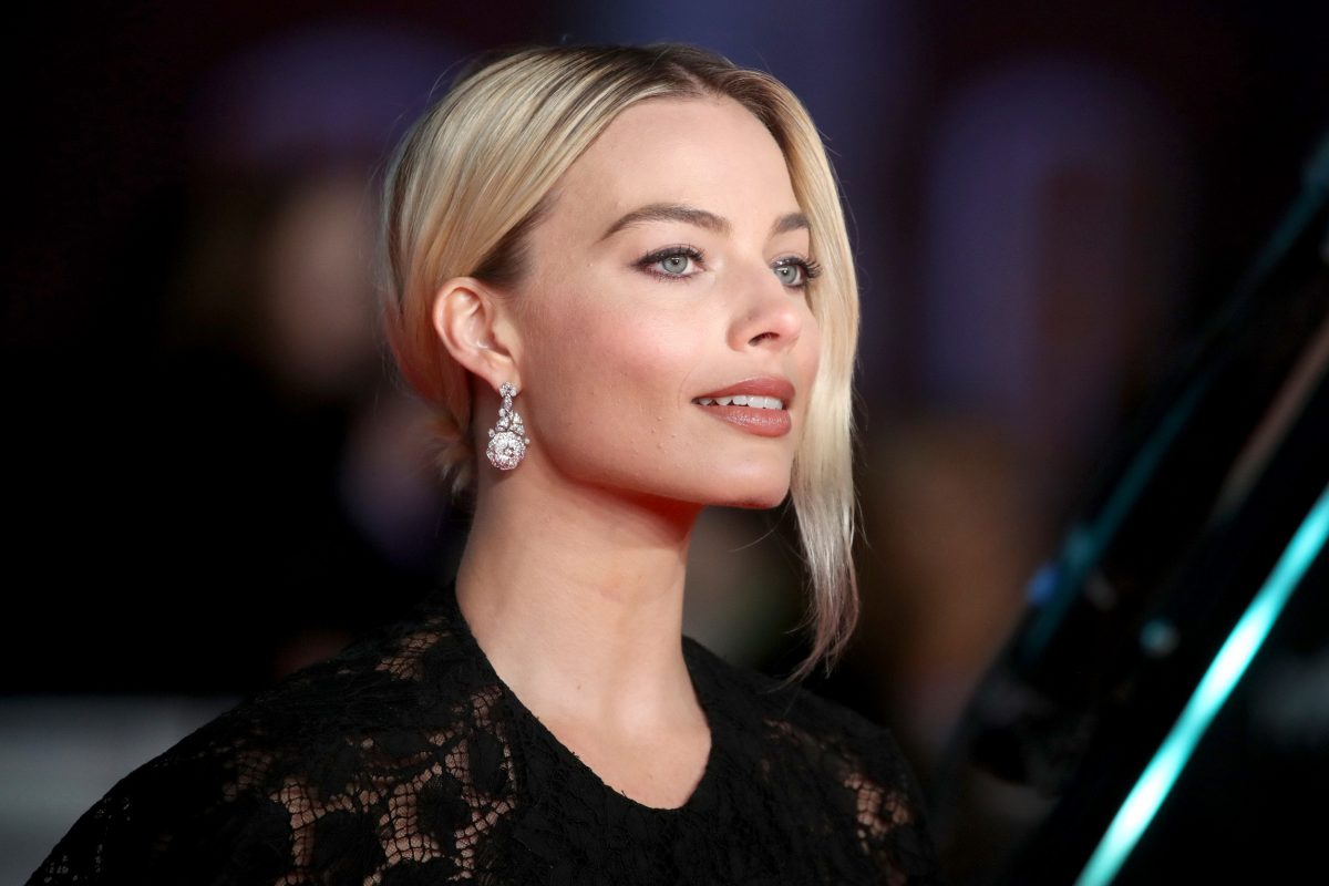 Harley Quinn actor Margot Robbie wearing a black dress on the red carpet