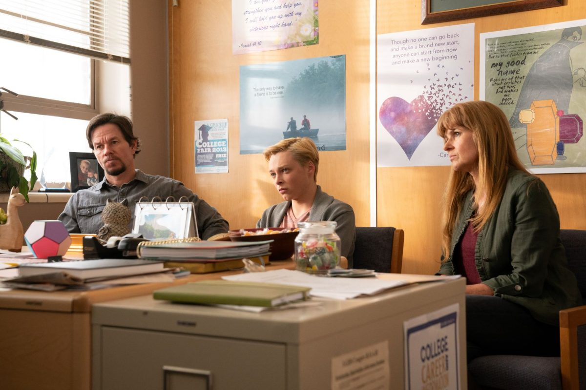 Mark Wahlberg, Reid Miller and Connie Britton sit in the school office