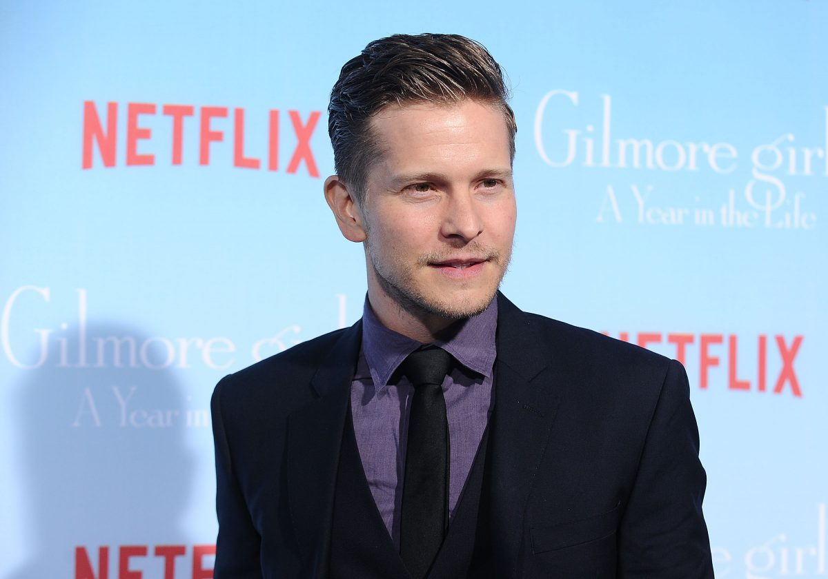 Matt Czuchry poses for a photo at the premiere of 'Gilmore Girls: A Year in the Life' in 2016