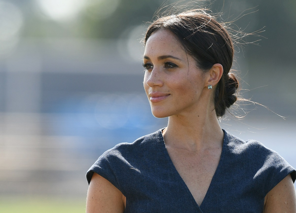 Meghan Markle looking on as she attends the Sentebale ISPS Handa Polo Cup