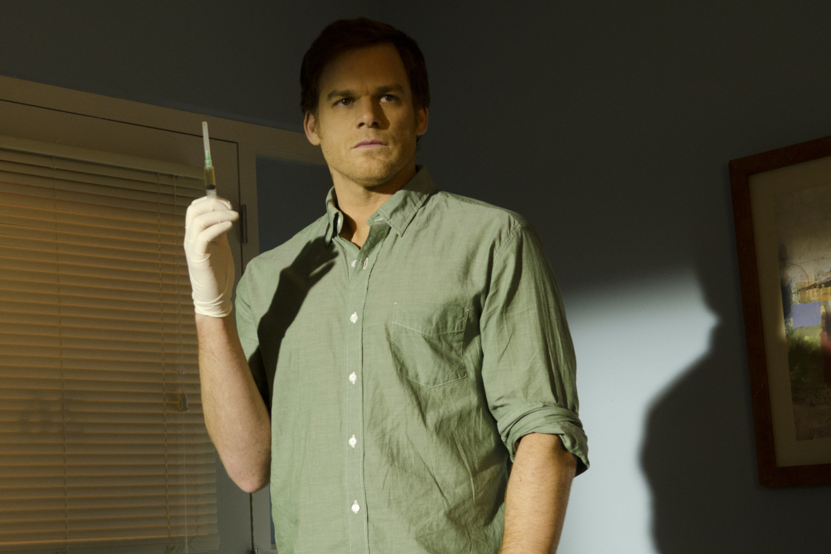 Michael C. Hall as Dexter holds up a syringeholds up