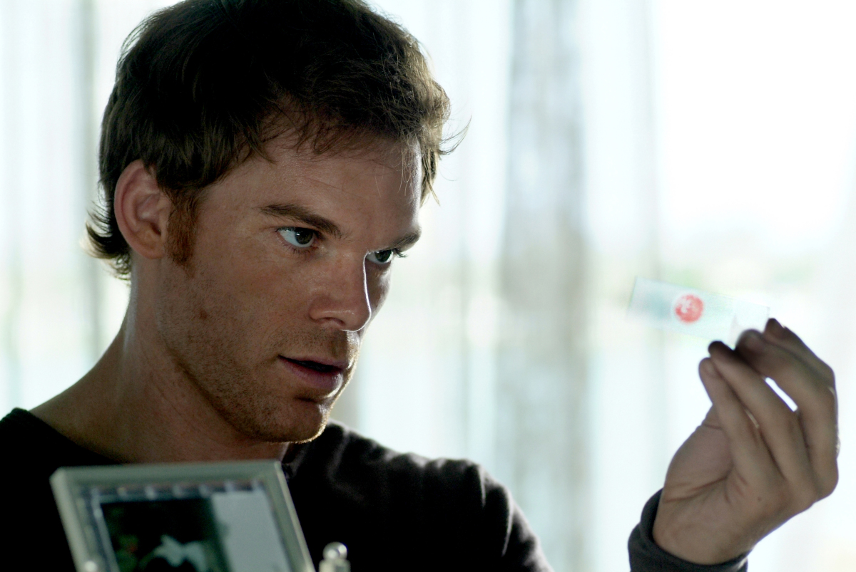 Michael C. Hall holds up a slide of blood in Dexter