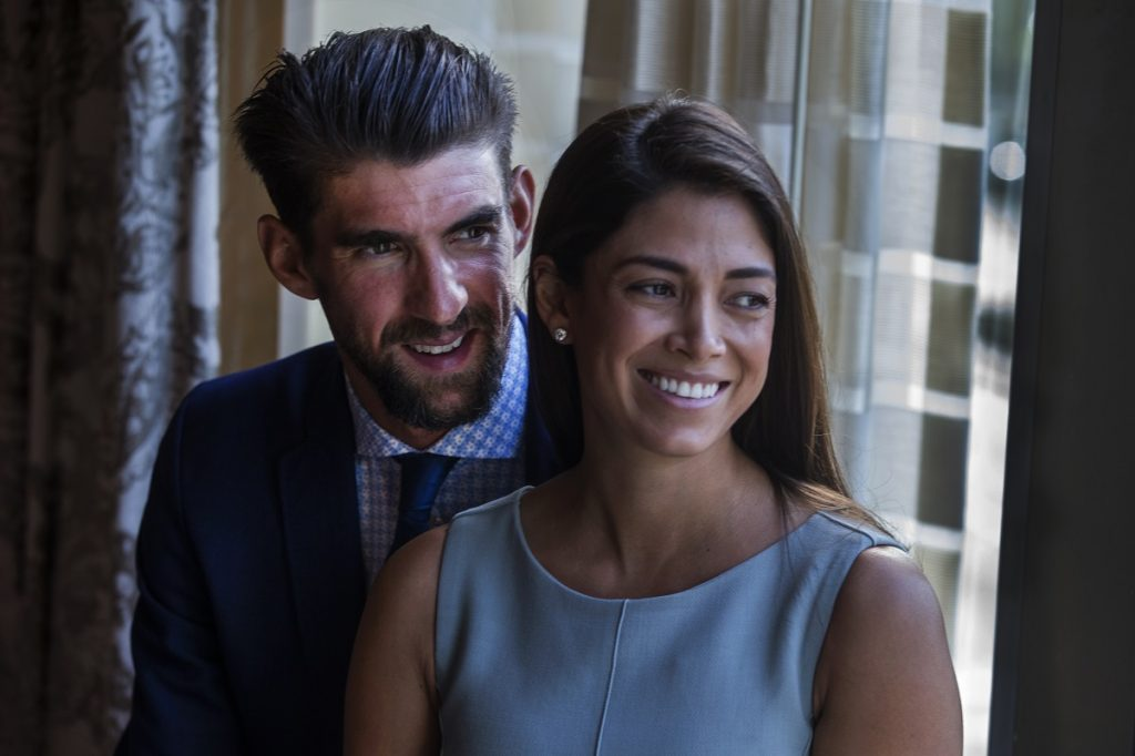 Michael Phelps and his wife Nicole Johnson smiling before receiving the Morton E. Ruderman Award