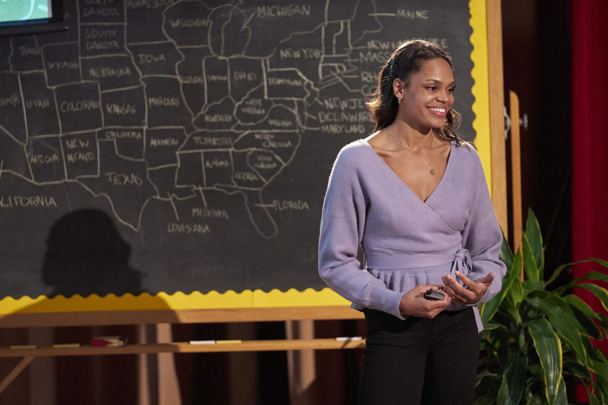 Michelle Young smiling in front of a chalk board on 'The Bachelor.' She's the next star of 'The Bachelorette'