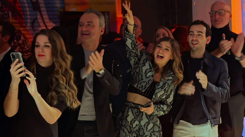 Cast members of 'My Unorthodox Life' cheering in a crowd