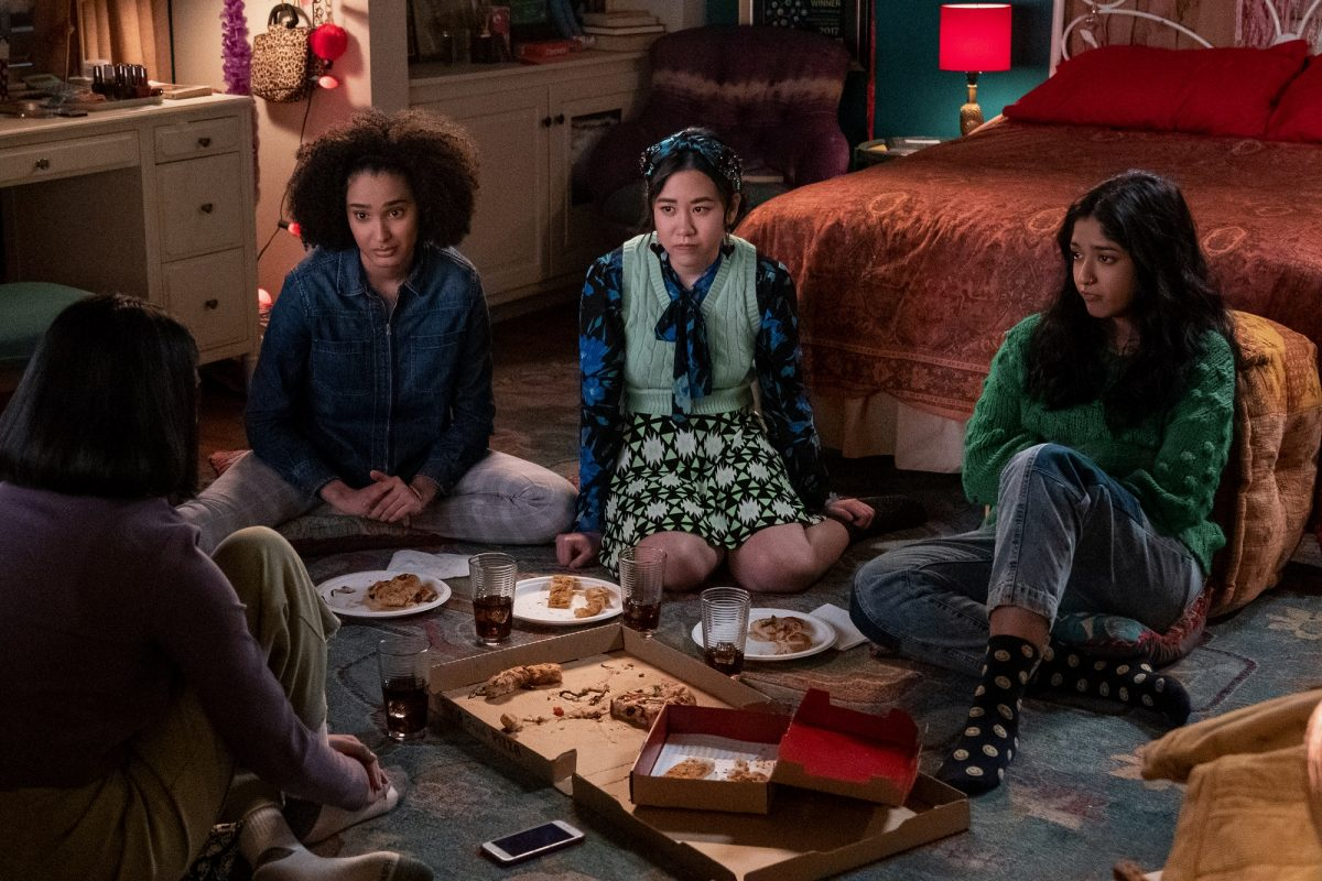 Aneesa, Fabiola, Eleanor, and Devi sit on the floor of Devi's bedroom in 'Never Have I Ever'