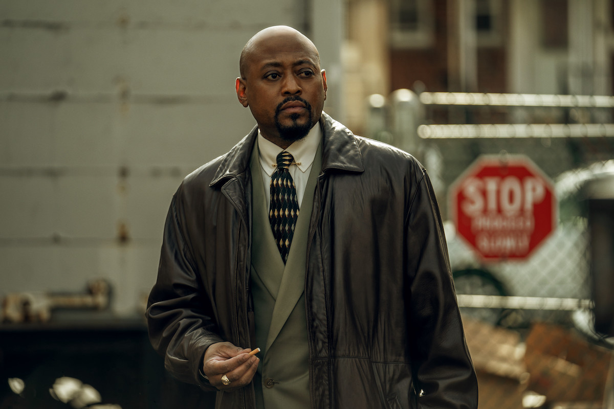 Omar Epps waring a suit and holding a cigarette as Detective Malcolm Howard in 'Power Book III: Raising Kanan'