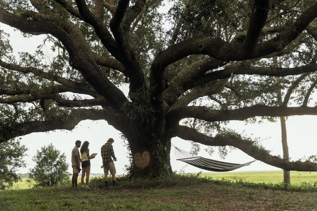 JONATHAN DAVISS as POPE, MADISON BAILEY as KIARA and RUDY PANKOW as JJ in 'Outer Banks' Season 2, Episode 1 'The Gold'