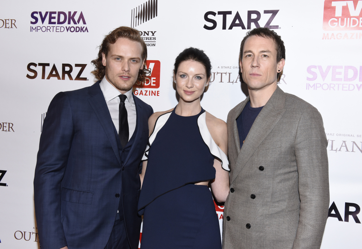 """Sam Heughan, actress Caitriona Balfe and actor Tobias Menzies attend TV Guide Magazine Celebrates STARZ's """"Outlander"""" at Palihouse on March 30, 2016 in West Hollywood, California"""