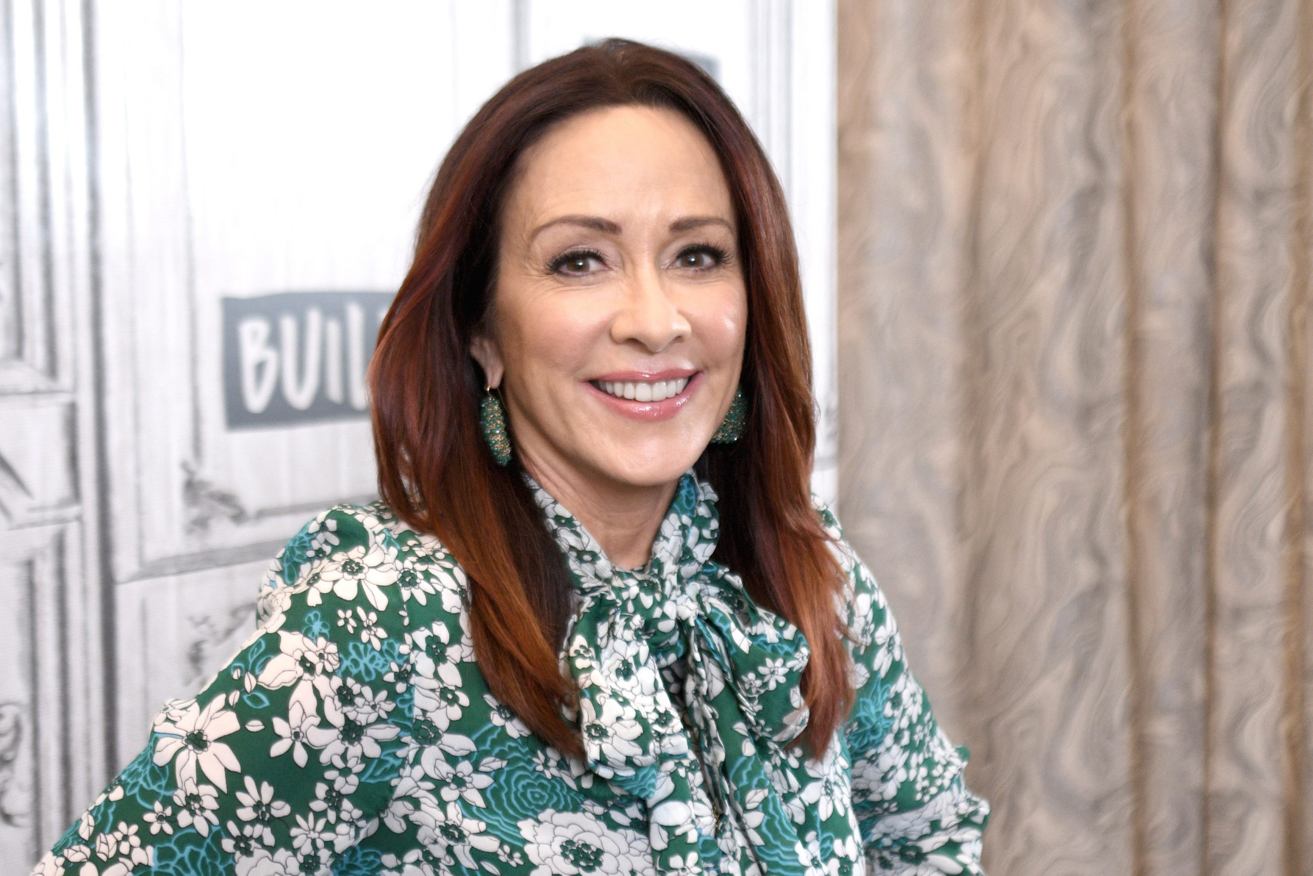 Actor Patricia Heaton smiles for the camera in a green-and-white print blouse in 2018.