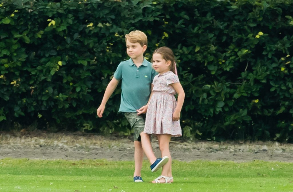 Photo of Prince George and Princess Charlotte playing together at The King Power Royal Charity Polo Day