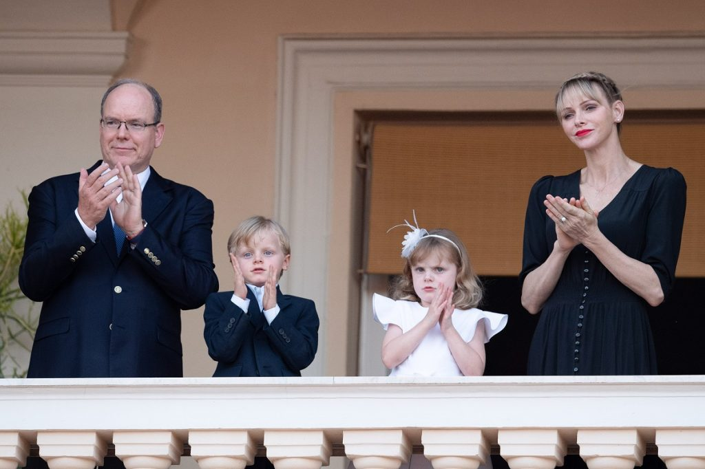 Prince Albert II of Monaco and Princess Charlene of Monaco clapping at event with their children Prince Jacques and Princess Gabriella