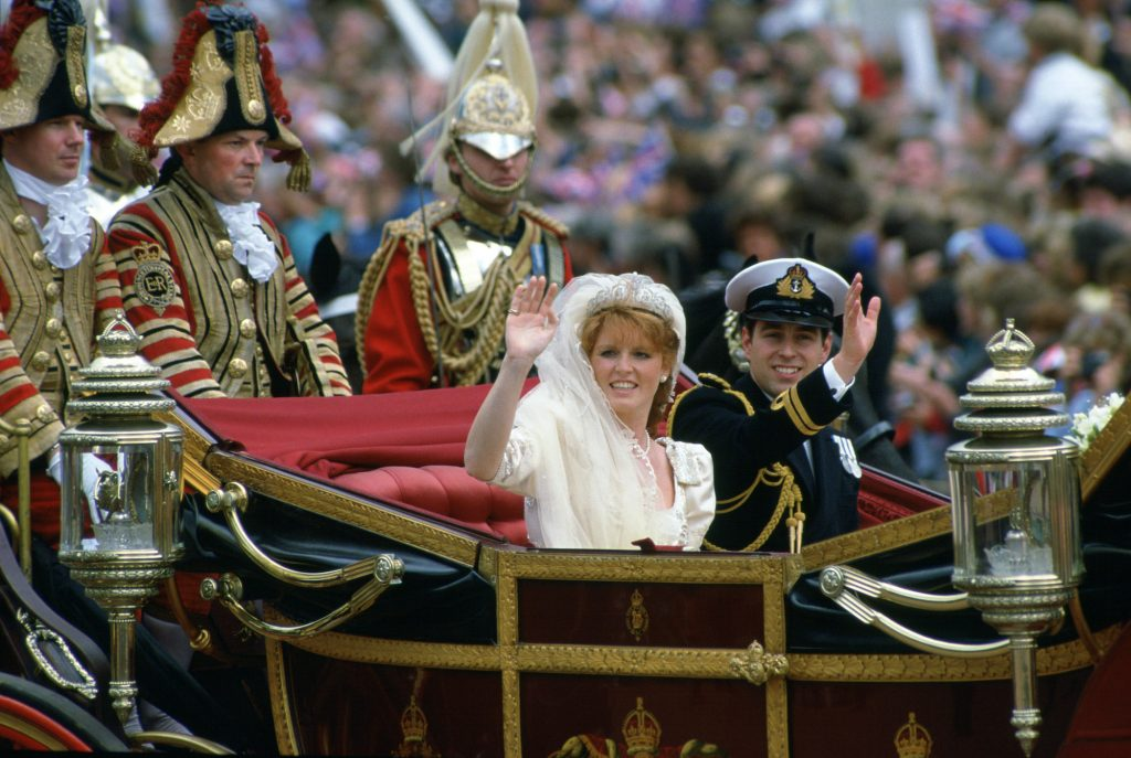 Sarah Ferguson and Prince Andrew waving from a carriage on their wedding day