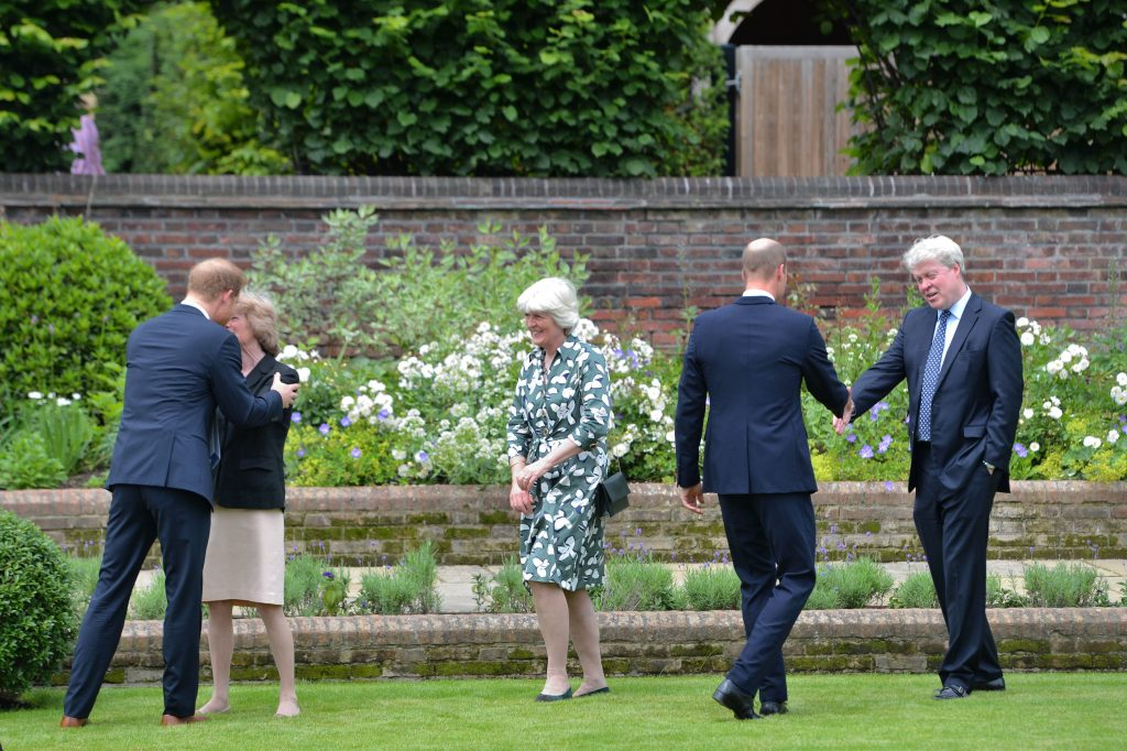 Prince Harry, and Prince William, greet Princess Diana's siblings Lady Sarah McCorquodale, Lady Jane Fellowes, and Earl Spencer at statue unveiling