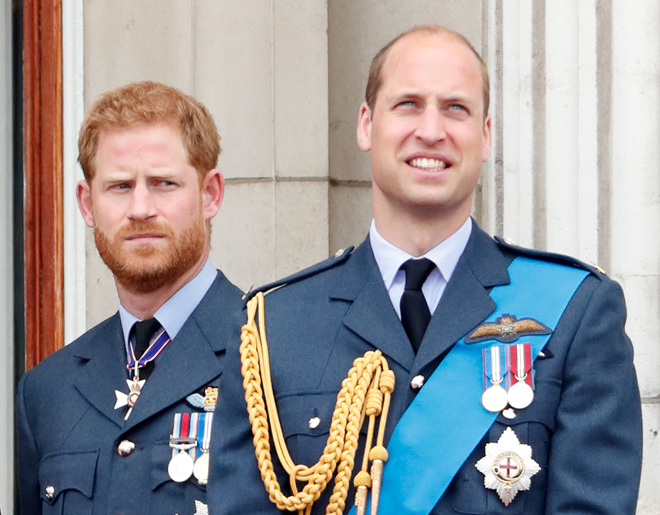 Prince Harry and Prince William watch a flypast on balcony of Buckingham Palace