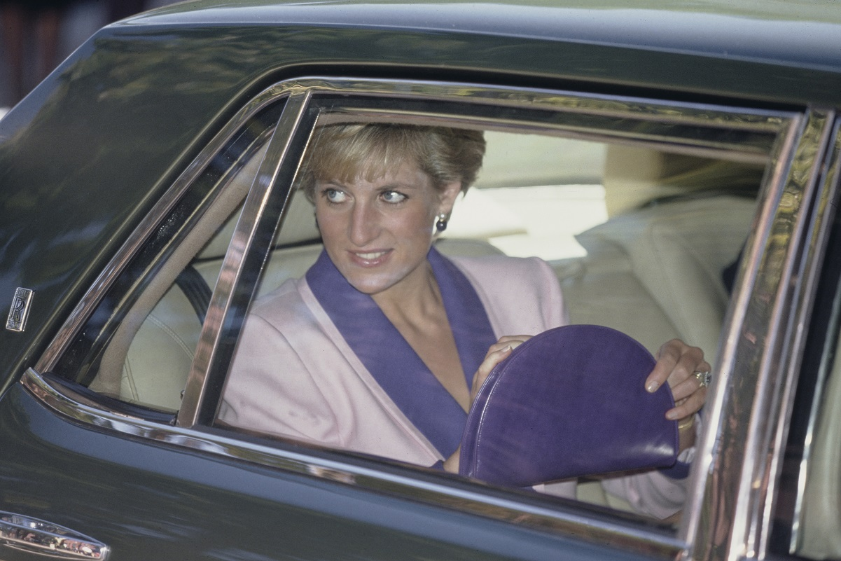 Princess Diana traveling in a car for a visit to a center for children with HIV in Washington, D.C.