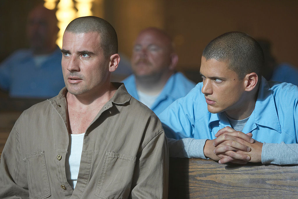 Wentworth Miller and Dominic Purcell are set to reprise their roles as Michael Scofield and Lincoln Burrows sit in prison jumpers with concerned looks on their faces.