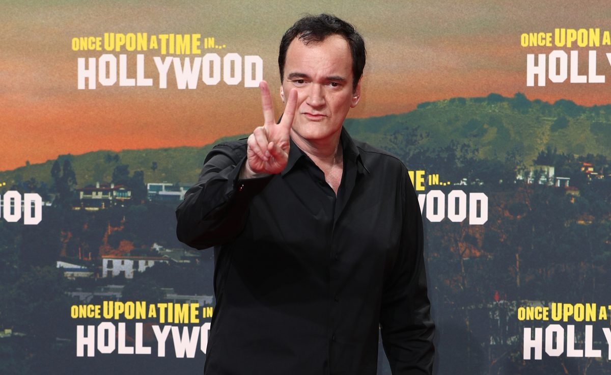 Quentin Tarantino flashes two fingers on the red carpet