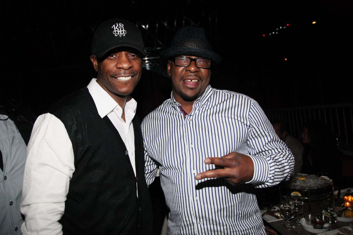 Keith Sweat and Bobby Brown pose for a photo together at a dinner in New York City