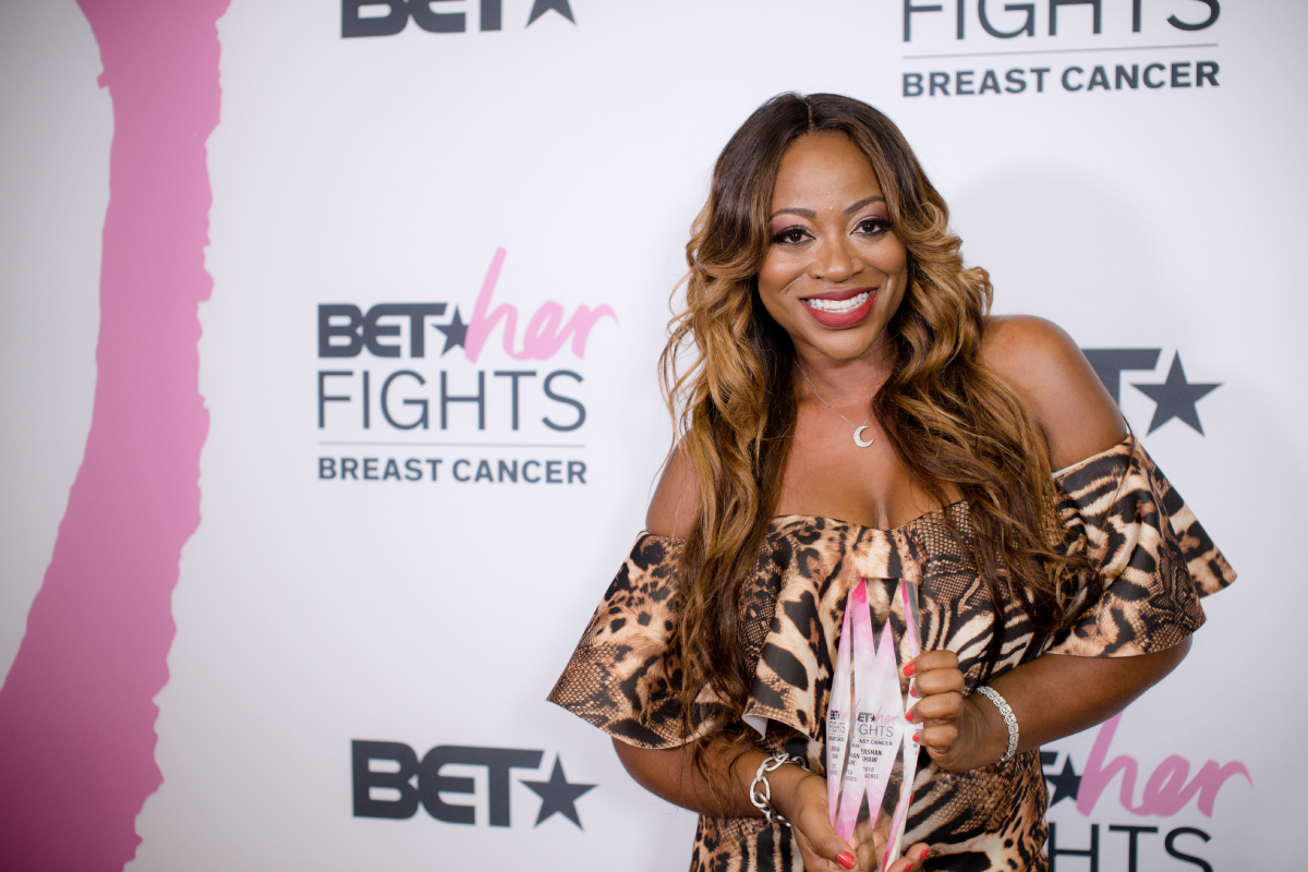 'RHONY' newbie Bershan Shaw poses with the 2018 Honoree award backstage during the 'BET Her Fights Breast Cancer' special event at Riverside Epicenter on September 20, 2018 in Atlanta, Georgia