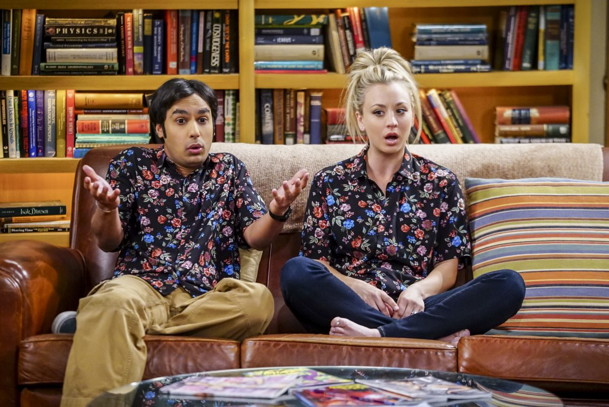 """Raj Koothrappali and Penny sit on the couch in Leonard and Sheldon's apartment in """"The Big Bang Theory"""""""