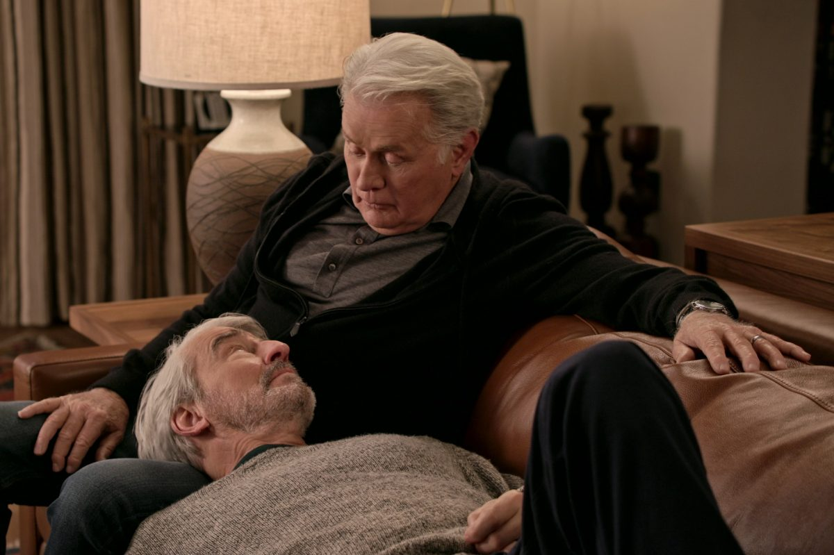 Robert Hanson and Sol Bergstein sit on a couch together in a scene for 'Grace and Frankie'