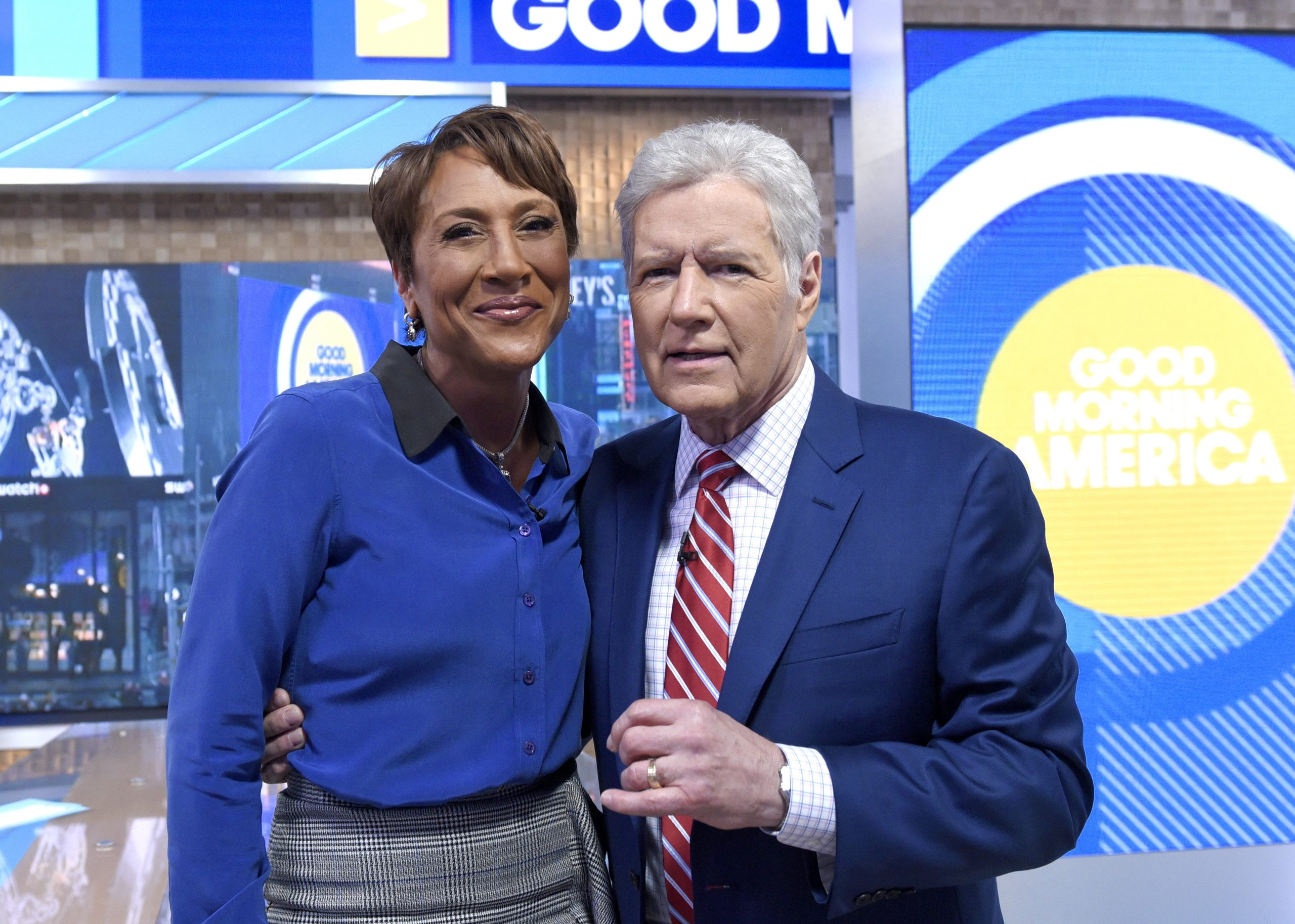 'GMA' coanchor Robin Roberts and late 'Jeopardy!' host Alex Trebek stop for a photo in the morning show's studios in 2019.