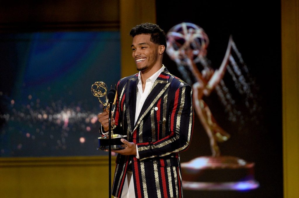 Robin Flynn from 'The Bold and the Beautiful' that played Zende accepting an award in a black, gold, and red striped suit jacket and white button-up shirt.