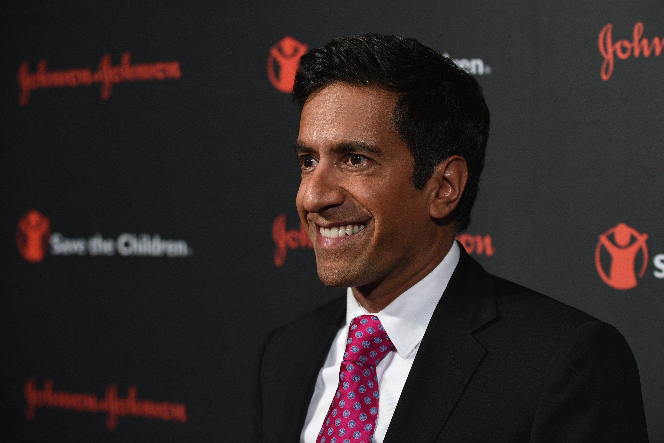 CNN's Dr. Sanjay Gupta smiles as he attends an event in 2015.